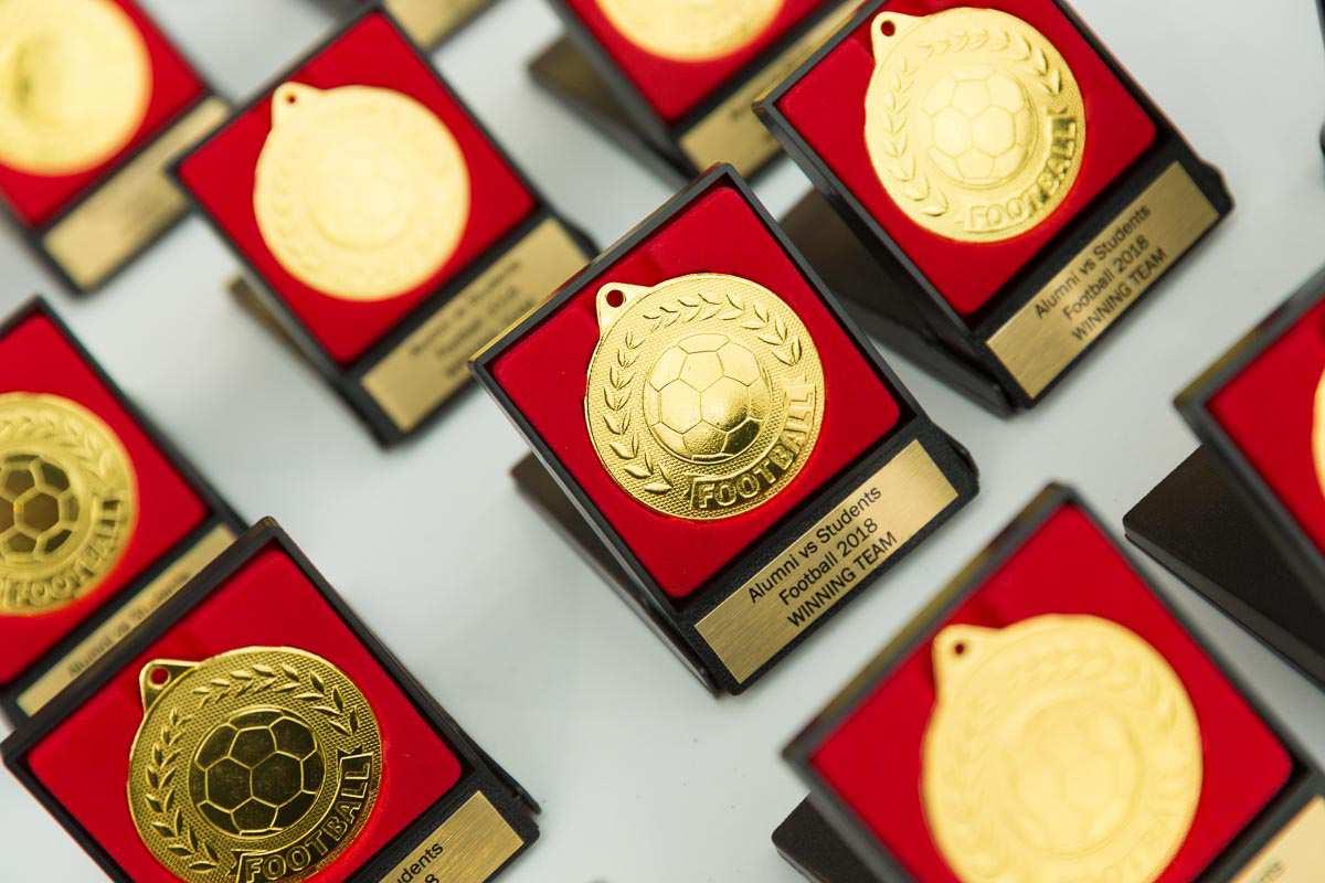 inaugural alumni student footy tournament 2018 - winning team medals