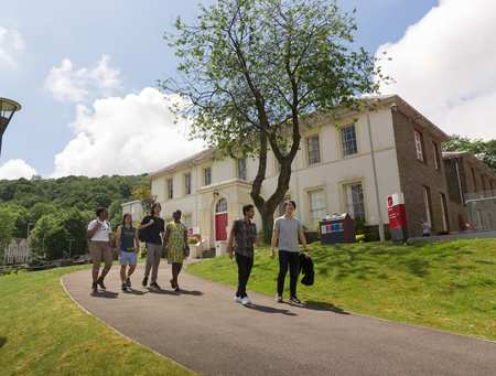 International students in front of Ty Crawshay