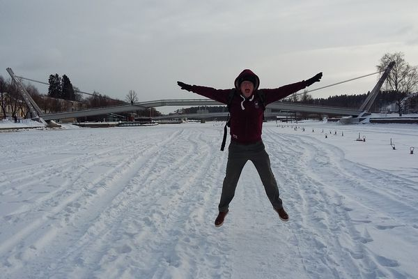 Testing the strength of the ice on the frozen river Porvoonjoki in Porvoo