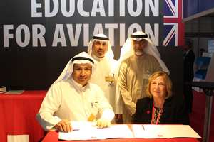 Abdullah Al Anez, Kuwait Airways, and Professor Julie Lydon, USW, sign the Memorandum of Agreement at the Dubai Airshow.jpg