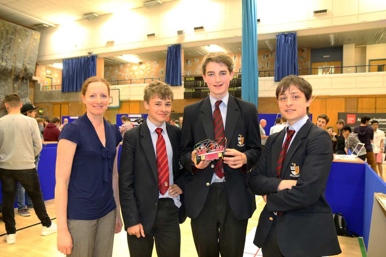 Amy Finney, computer teacher, Adam Robarts, 16, Ollie Stubbs, 15, and Alex West, 14, of Bristol Grammar School.