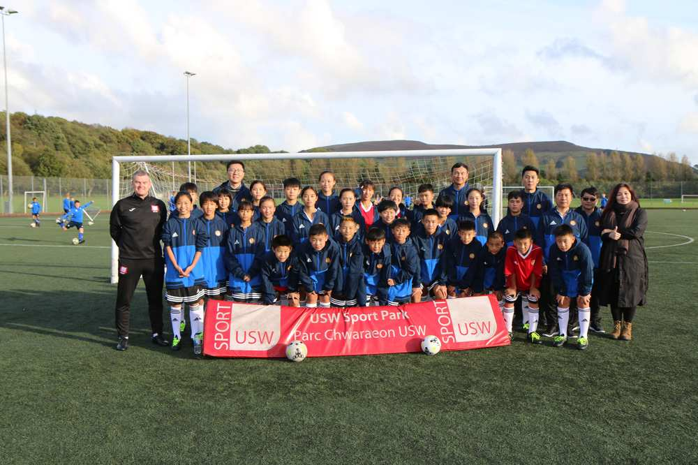 Young footballers from China have tested their on-field skills during a visit to South Wales. The group of 28 students, support staff and media team were on an eight-day trip hosted by USW and the FAW Trust. Neil Gibson, October 2017