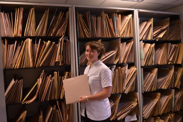 A final year chiropractic student in the patient file room