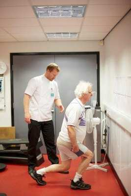 Supervising exercises designed to increase hip range of motion and improve balance