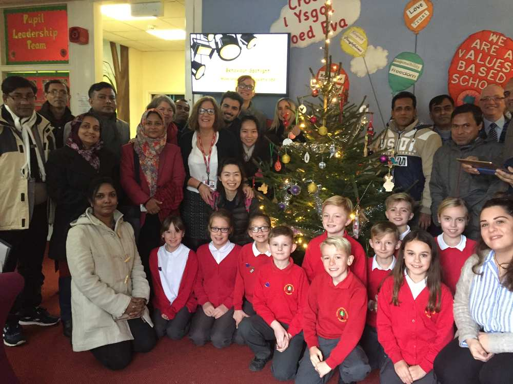 Pupils and Gill Ellis, headteacher of Coed Eva Primary School in Cwmbran, welcoming USW students to a Nativity Play on   December 2 . Neil Gibson