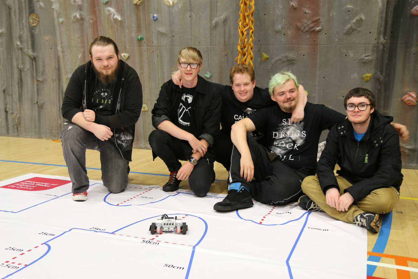 Connor Gibbs, 19, Gethin Callaghan, 19, Butch Renwick, 26, Suonie Jones, 18, and Aaron Phillips, 18, all from Coleg Y Cymoedd's Ystrad Mynach campus, worked on the robot programming challenge.