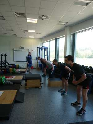 Des Ryan of Arsenal Academy instructs the students on the hip hinge
