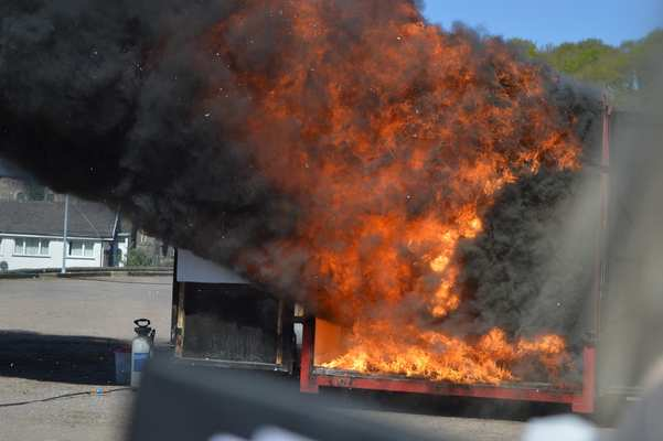 Following flashover, the products of combustion (smoke) burn as they leave the compartmental fire enclosure and encounter the outside oxygen containing air.