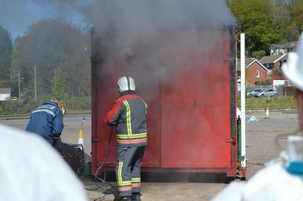 The container doors are closed to stop the fire development.