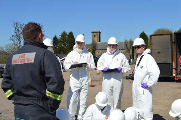 South Wales Fire and Rescue Fire Investigator Matt Jones discusses the elements of the fire scene and the investigation with the students.