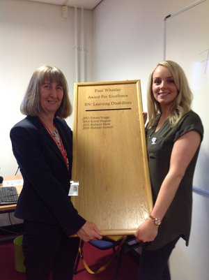 Hannah Samuel receiving the Paul Wheeler Award from Professor Ruth Northway, Professor of Learning Disability Nursing at USW