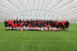 The Hong Kong team and visitng schoolchildren at the USW Sport Park.