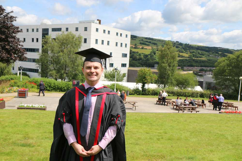 Michael Griffiths has Tourette's. He graduated with a degree in adult nursing