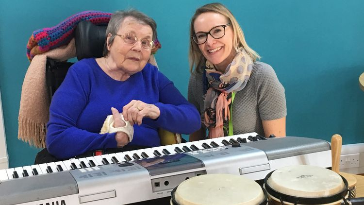 Betty and Lynnsey, MA Music Therapy student, at City Hospice