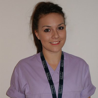 A student Jess in scrubs!