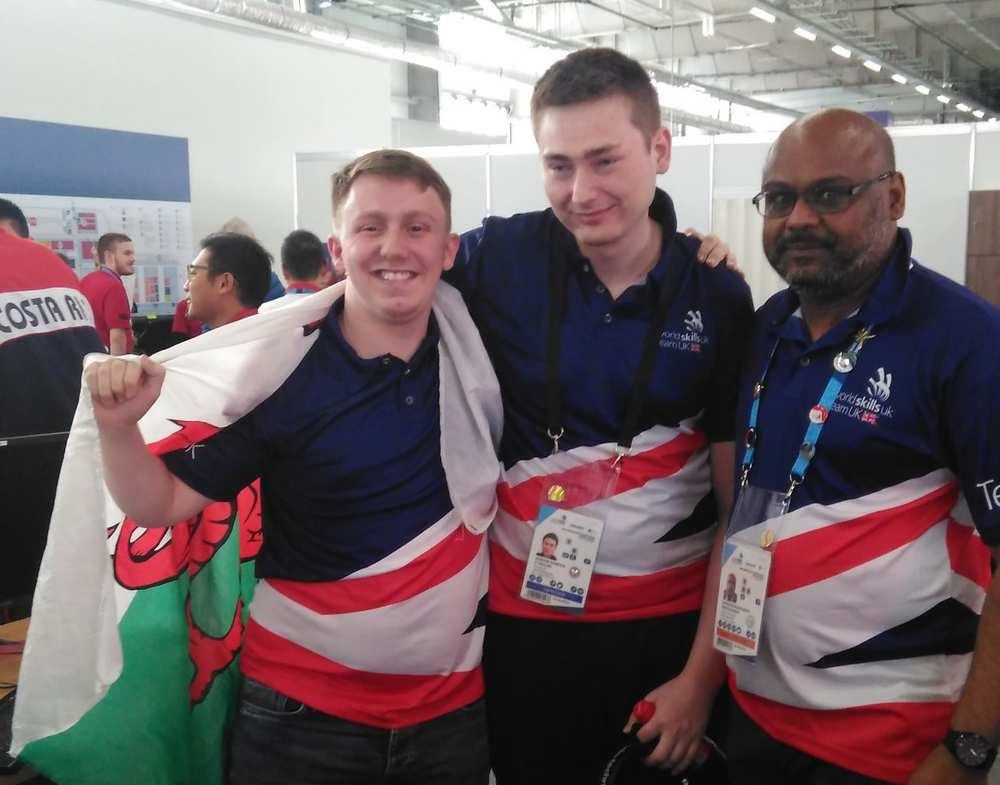 World Skills. August 2019. Kyle Woodward with fellow competitor Adrian Cybulski and Suresh Kamadchisundaram, WorldSkills UK Training Manager