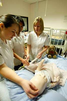 Student nurses treating BabySim in the Paediatric Suite