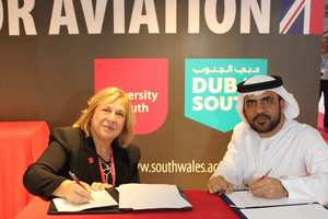 Professor Julie Lydon and Captain Yahya Alboloushi sign the agreement at Dubai Airshow 2017.jpg