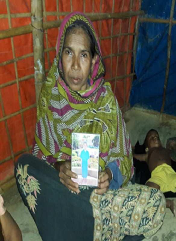 Dr Palash Kamruzzaman: Rohingya mother showing son pic in Myanmar prison.jpg