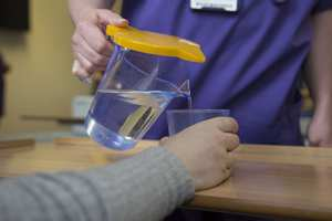 Team hydr8, yellow jug lids, adult nursing students