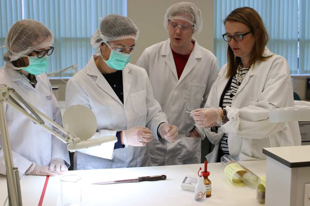 Kirsty Williams, Welsh Government education secretary, sees the work of USW forensic science students at first-hand. Neil Gibson