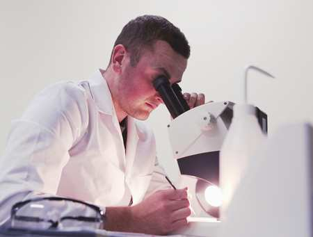 Medical Sciences student using a microscope