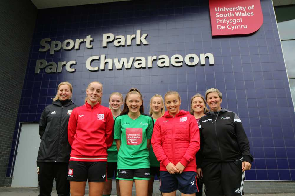 Wales manager Jayne Ludlow (left) with young footballers who will benefit from the partnership; Mel Tuckwell (second from right), USW lecturer in Sports Coaching and Performance, and Claire O'Sullivan, Head Coach of the Wales Elite Youth Football Academy.