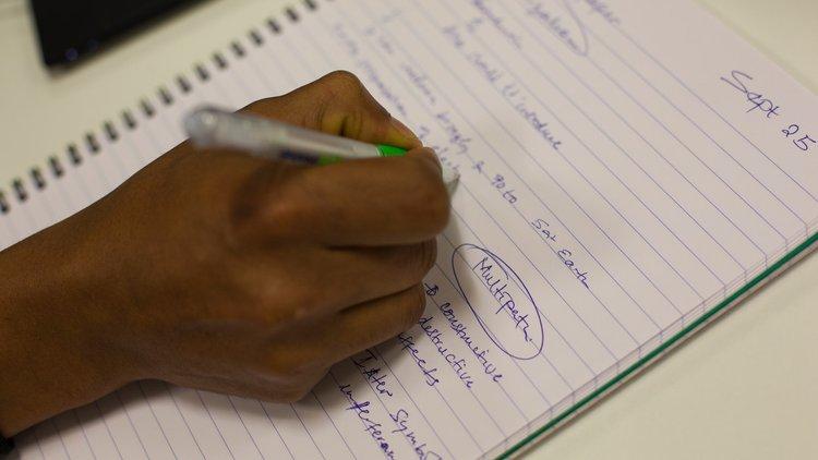 Writing in pad of paper.jpg