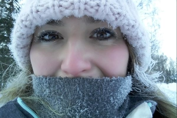 Frozen eyelashes, hair and scarf after a chilly walk to placement in -23 degrees celsius